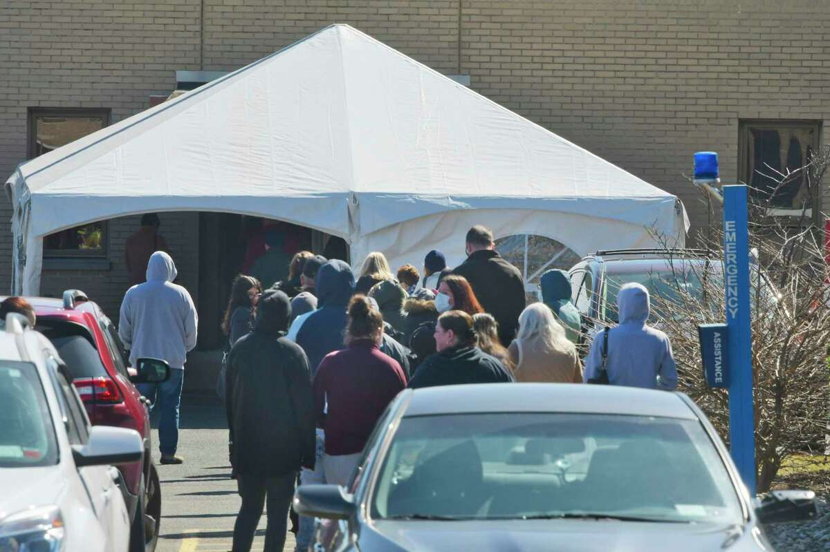 People line up outside Albany Memorial Hospital as they wait to get tested for COVID-19 on Monday, March 16, 2020, in Albany, N.Y. (Paul Buckowski/Times Union)