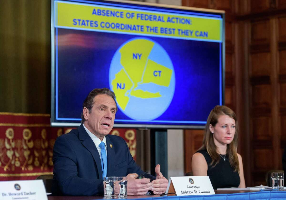 Gov. Andrew Cuomo holds a briefing on coronavirus where he announced partnerships with New Jersey and Connecticut to close bars, restaurants, movie theaters, gyms, casinos and limit public gatherings to 50 people starting at 8 p.m. on Monday, March 15, 2020, in the Red Room at the Capitol in Albany, N.Y. Bars and restaurants can remain open for takeout and delivery only, and will be granted a waiver for carry-out alcohol.