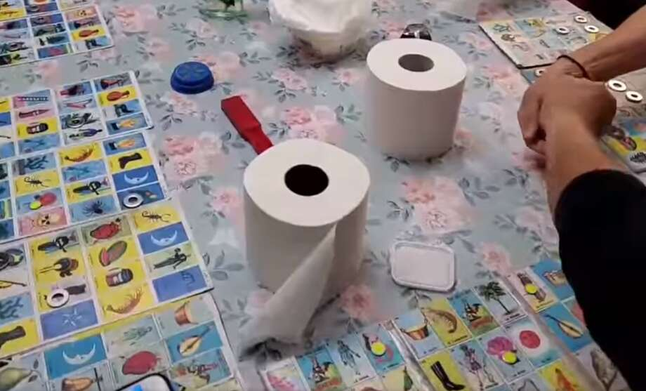 """With toilet paper running low at stores across the nation due to fears of coronavirus, one family from Brownsville decided to have some """"light-hearted fun"""" and play Lotería with the scarce product. Photo: Julie Hernandez"""