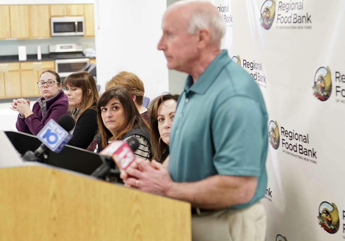 Staff from the Regional Food Bank of Northeastern New York look on as Mark Quandt, the executive director, talks to members of the media at a press conference on Monday, March 16, 2020, in Colonie, N.Y. (Paul Buckowski/Times Union)