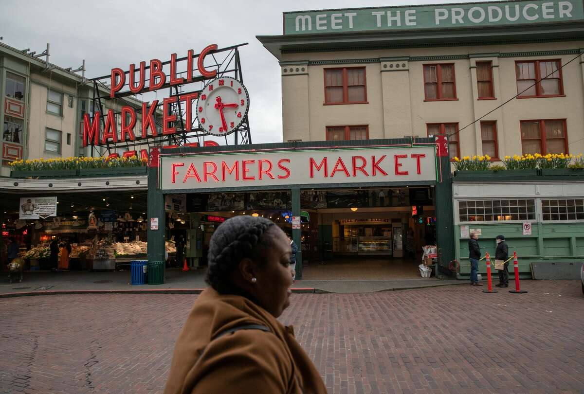 The Pike Place Market sits virtually empty of patrons on March 10, 2020 in downtown Seattle, Washington. The historic farmer's market is Seattle's most popular tourist attraction, and business has been especially hard hit by coronavirus fears.