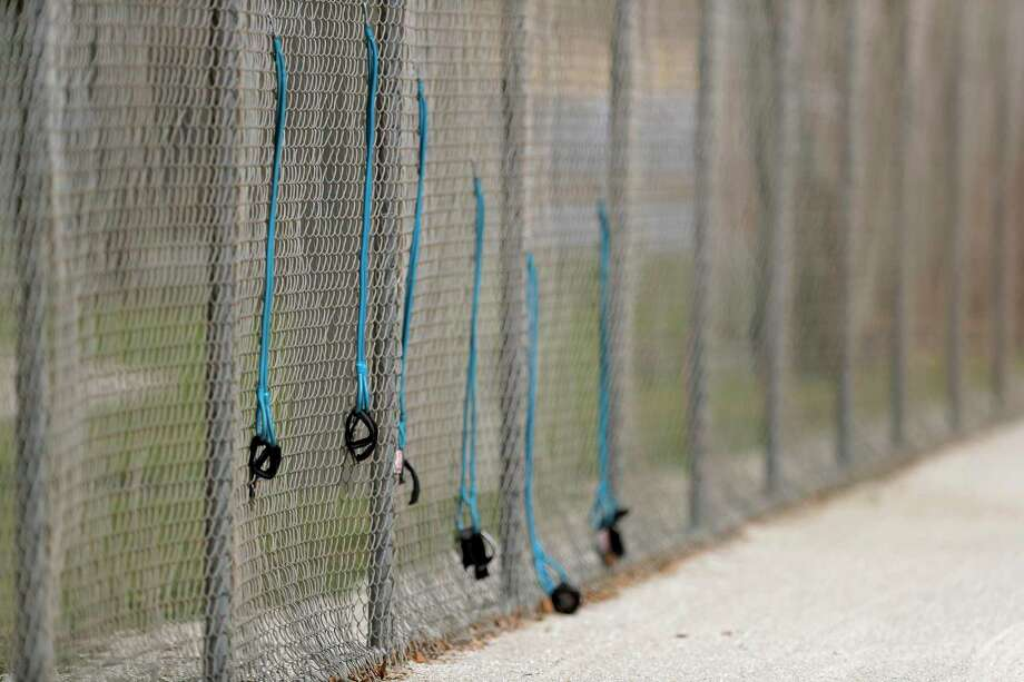 A stretch area on the fence of an empty practice field is seen at the Miami Marlins spring training baseball facility in Jupiter, Fla. Photo: Associated Press / Copyright 2020 The Associated Press. All rights reserved.
