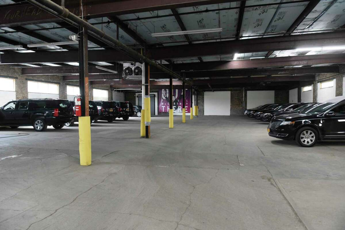 Many vehicles are seen in a garage at Premiere Transportation on Monday, March 16, 2020 in Albany, N.Y. This garage is usually almost empty at this time of day. (Lori Van Buren/Times Union)