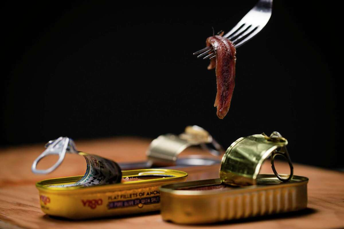 Anchovies, commonly found brined and packed in oil in tins, add dimensions of flavor to salads, pastas, vinaigrettes and sauces.