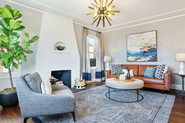 A starburst chandelier lends a vibrant flourish to this home in Richmond that was remodeled and staged by Emeryville's The Design Shop.