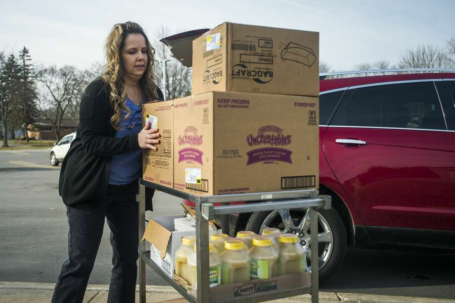 School breakfasts and lunches are available for students to pick up Monday, March 16, 2020 at Adams Elementary. Several Midland Public School school buildings, as well as other designated pick-up locations, will be open for meal pick-up on Monday, Wednesday, and Friday until April 3. (Katy Kildee/kkildee@mdn.net) Photo: (Katy Kildee/kkildee@mdn.net)