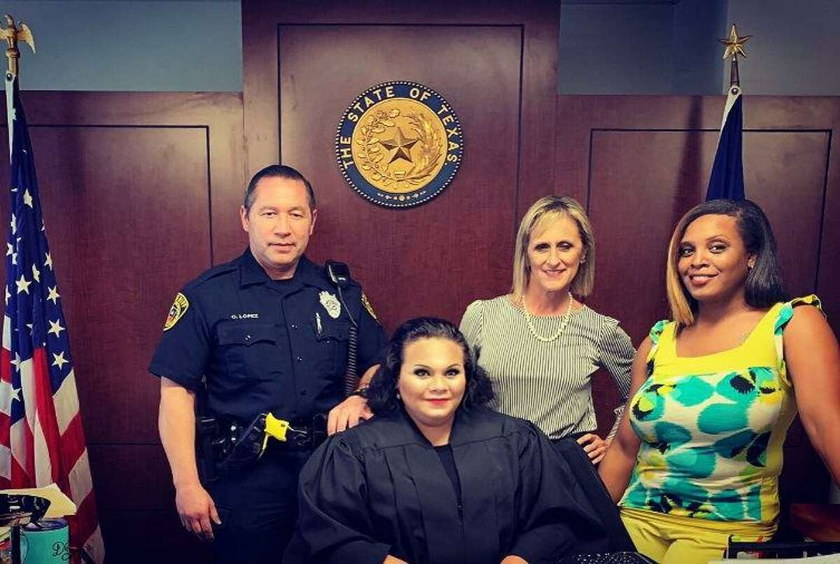 State District Judge Cynthia Chapa, seated, presides over the 288th Civil District Court in Bexar County. Also shown are court baliff Charles Lopez, clerk of the court Stephanie Holman and court reporter Judy Stewart.