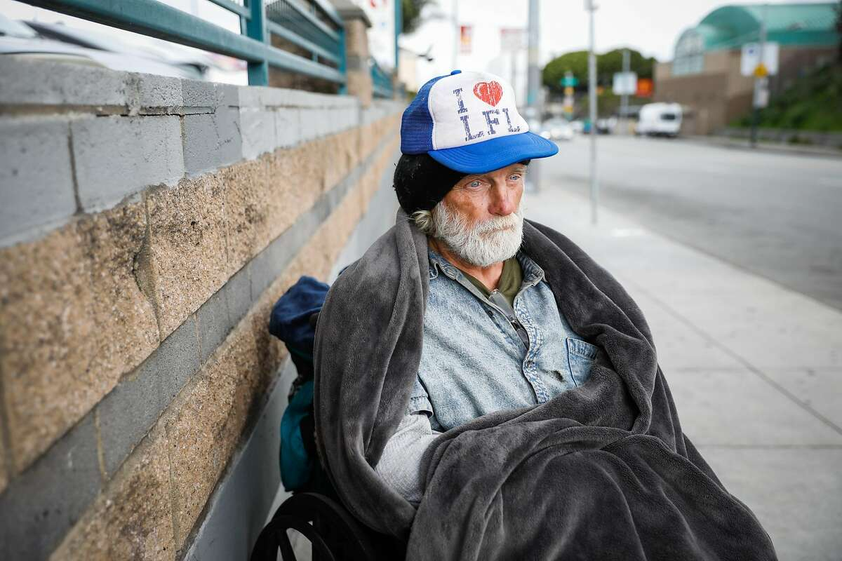 Homeless man Randy Duklin, 64, sits out on 16th Street on Sunday, March 15, 2020 in San Francisco, California.