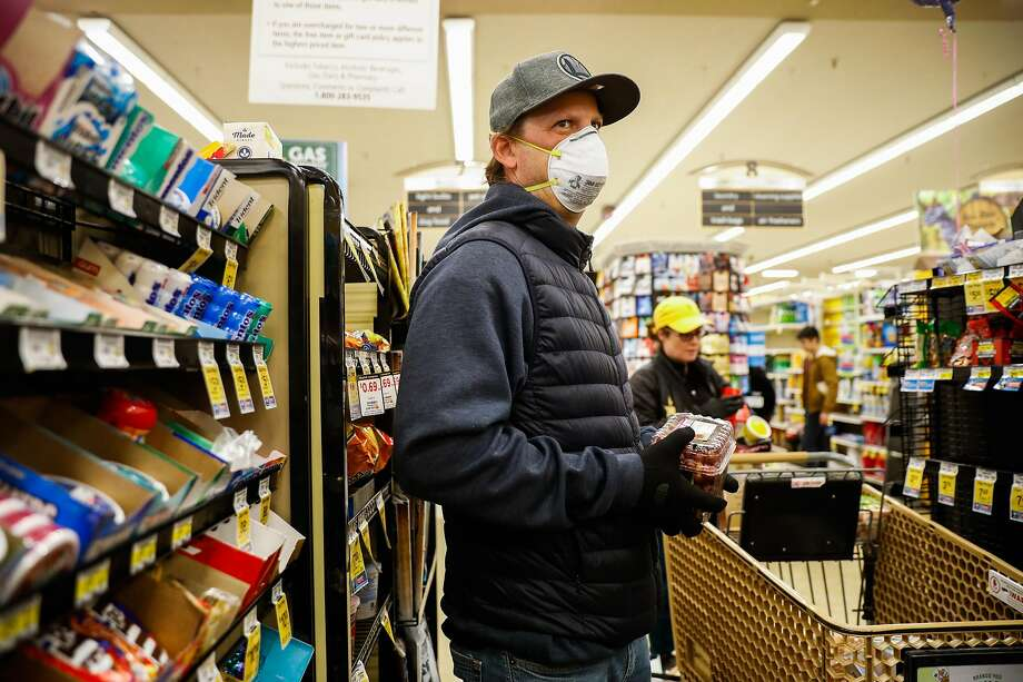 James Reed wears gloves and masks while shopping at Safeway on 16th Street on Sunday, March 15, 2020 in San Francisco, California. Photo: Gabrielle Lurie / The Chronicle