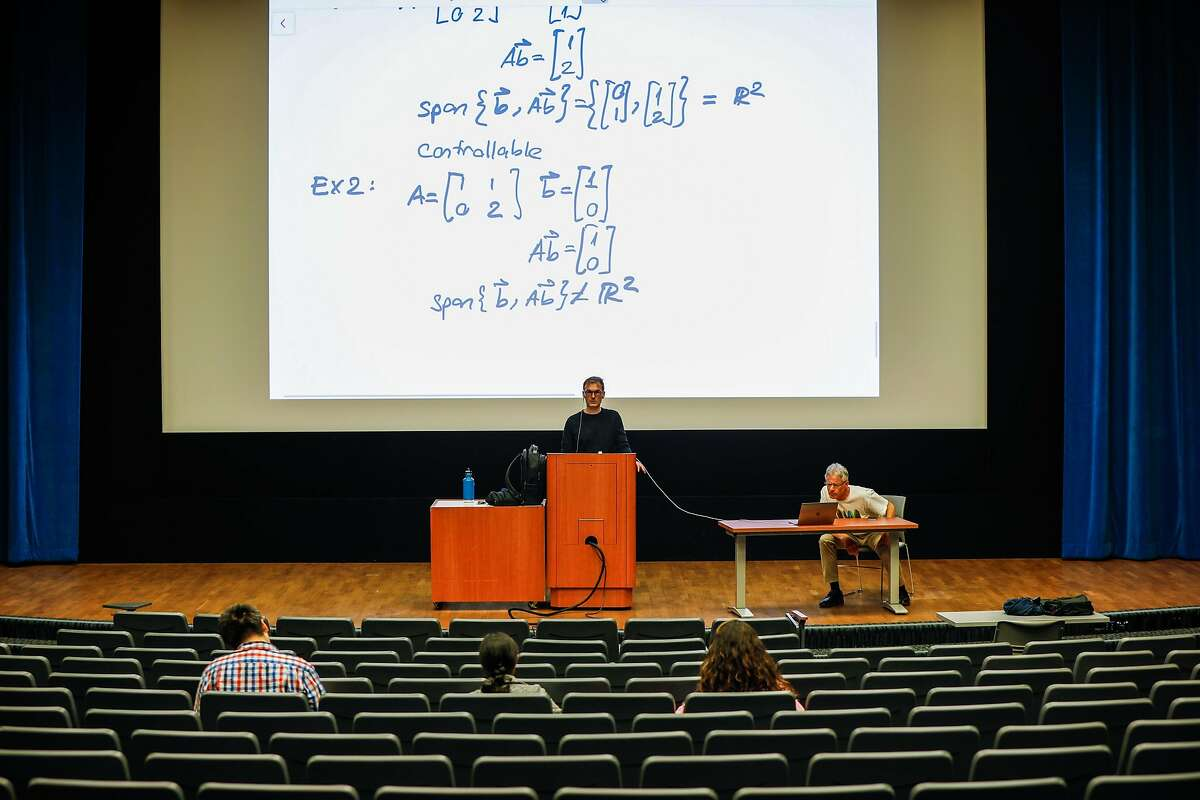 Professor Murat Arcak (center) and Professor Seth Sanders teach a Linear Systems class at Wheeler Hall where normally over 300 students are in attendance on Tuesday, March 10, 2020 in Berkeley, California.UC Berkeley announced yesterday that is has suspended in-person classes through the end of Spring break due to the coronavirus.