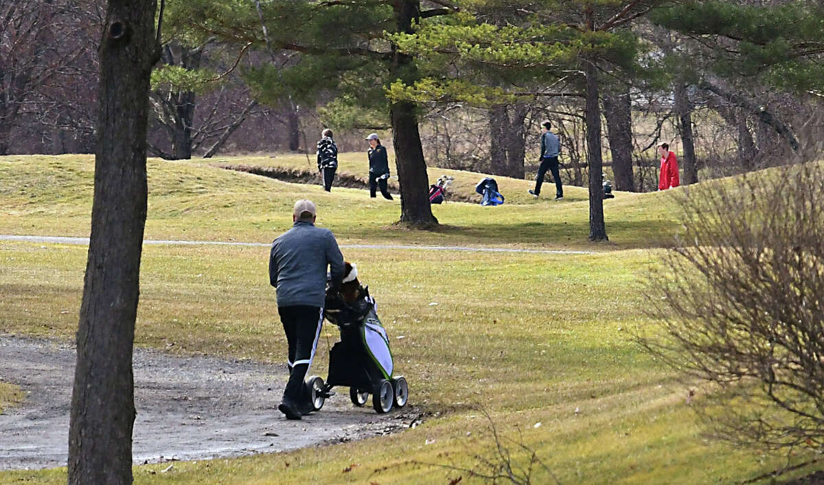Golfers are seen on the course at the Town of Colonie Golf Course on Monday, March 16, 2020 in Colonie, N.Y. The red nine at the course is open to golfers but the club house is closed. Someone will come outside to take money to play on the course. (Lori Van Buren/Times Union)