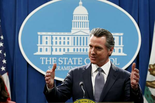 FILE - In this Thursday, March 12, 2020, file photo, California Gov. Gavin Newsom speaks to reporters about his executive order advising that non-essential gatherings of more than 250 people should be canceled until at least the end of March, during a news conference in Sacramento, Calif. Unlike other countries dealing with the coronavirus outbreak, the U.S. has left much of the response to its individual states. The response has been chaotic and led to concerns that the country has missed its golden hour to contain the virus. Now some of them, led by New York Gov. Andrew Cuomo, are calling for the federal government to take a more forceful and coordinated response before it's too late. (AP Photo/Rich Pedroncelli, File)