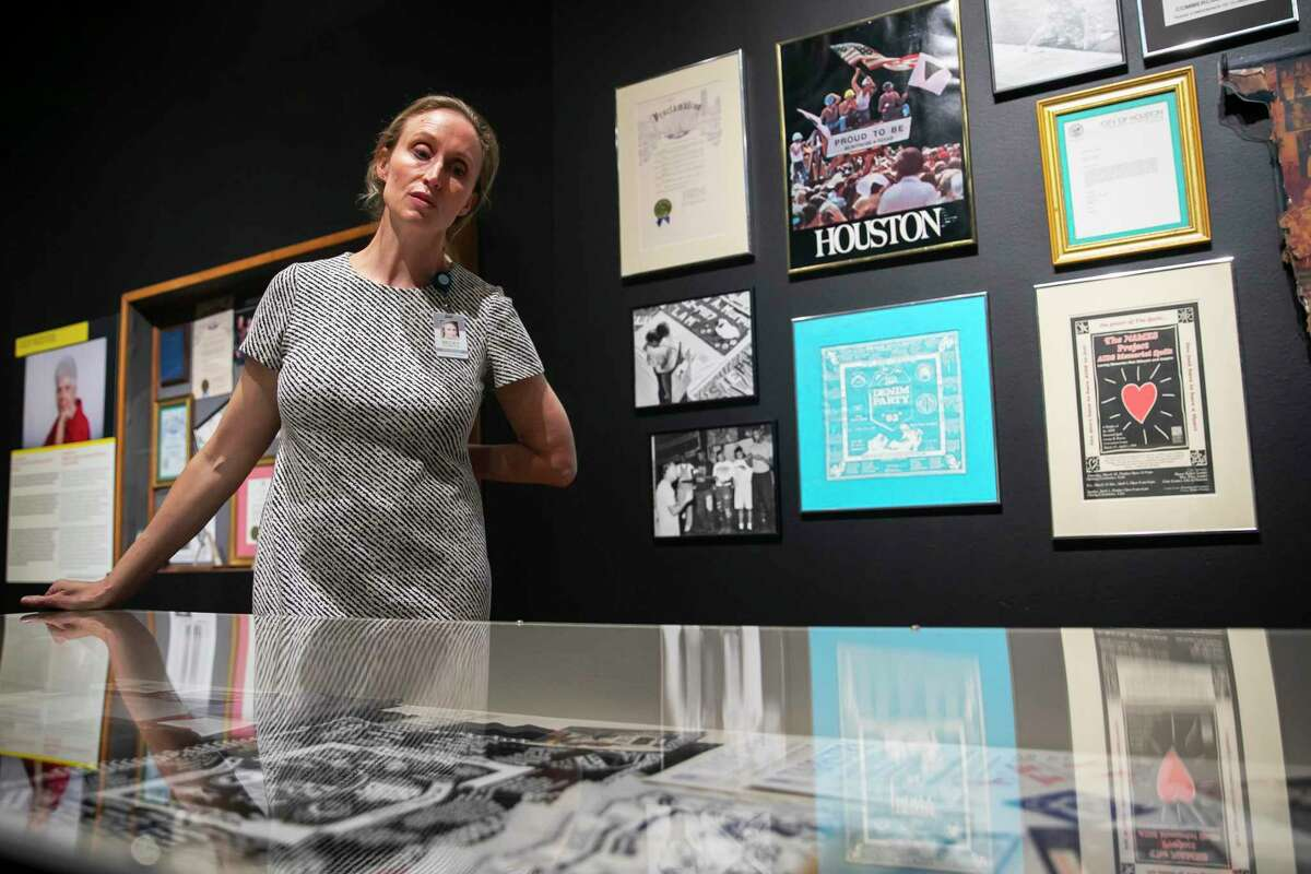 Becky Seabrook, Health Museum senior director of engagement, looks over personal artifacts collected from Houstonians in the Outbreak exhibit on Tuesday, Feb. 18, 2020. A section of the exhibit focuses on the HIV outbreak in Houston.