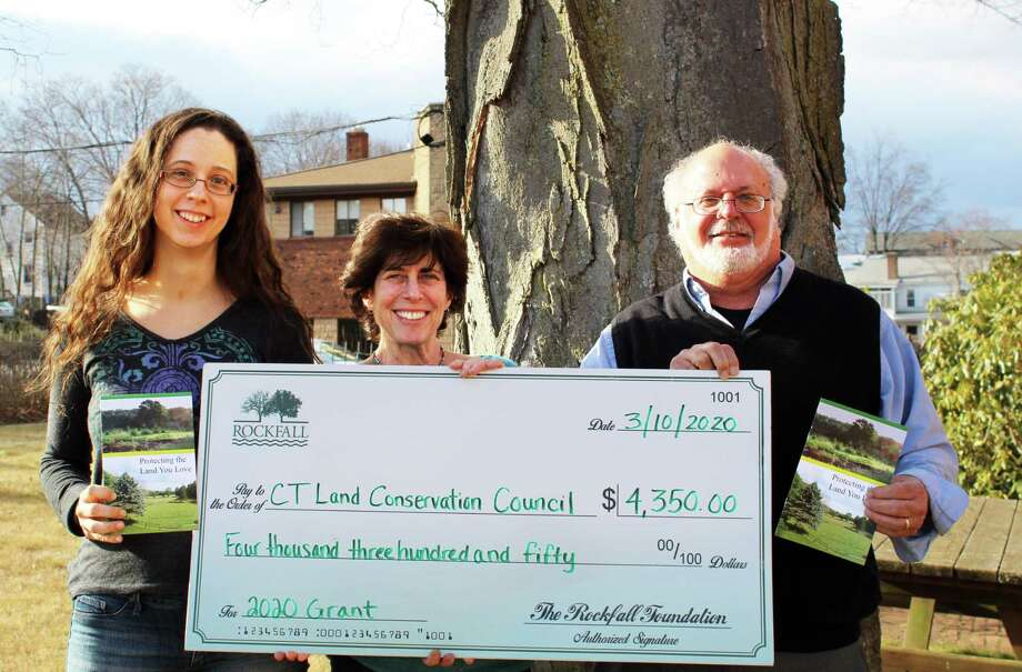 From left are Amanda Kenyon, Rockfall Foundation grants and communications coordinator; Amy Blaymore Paterson, Connecticut Land Conservation Council executive director; and Tony Marino, Rockfall Foundation executive director. They show off a $4,350 donation check. Photo: Contributed Photo