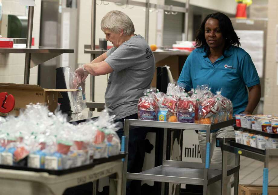 Veronica Barrett helps move freshly made meals as employees with Conroe ISD nutritional service prepare 1,000 meals for students at Conroe High School, Monday, March 16, 2020, in Conroe. Photo: Jason Fochtman, Houston Chronicle / Staff Photographer / Houston Chronicle  © 2020