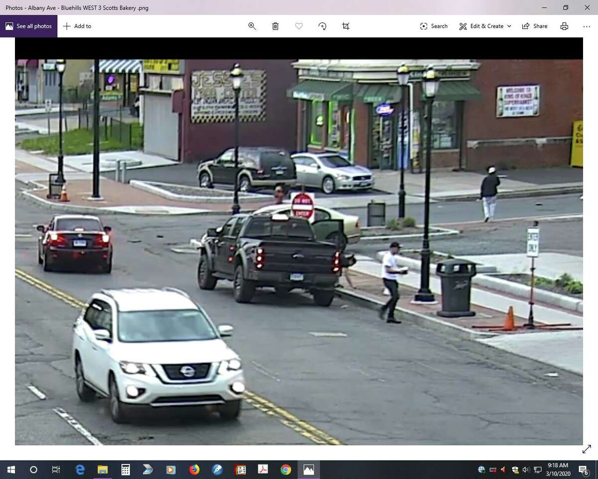 Still images of Hartford surveillance video that police say shows Fotis Dulos and Michelle Troconis the night Jennifer Dulos vanished. The images were included in motions filed Monday by Troconis' attorney.