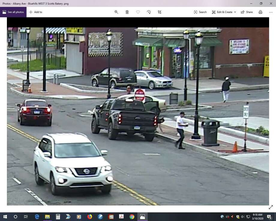 Still images of Hartford surveillance video that police say shows Fotis Dulos and Michelle Troconis the night Jennifer Dulos vanished. The images were included in motions filed Monday by Troconis' attorney. Photo: Contributed Photo
