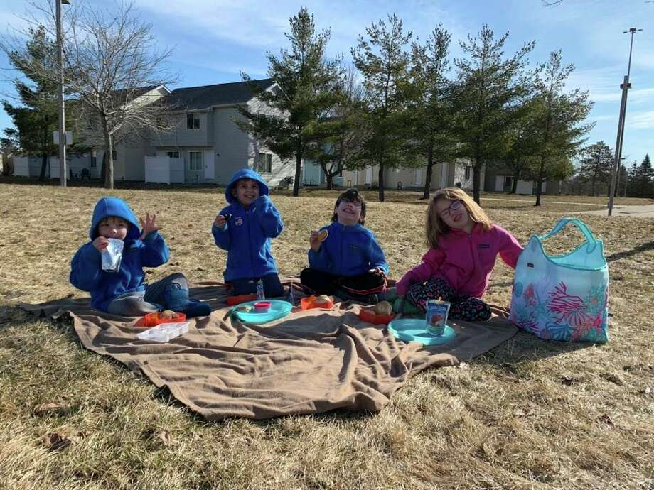 While keeping a safe distance from other people, Big Rapids mother of four Jackie Franklin has been keepingher kids active by doing fun activities like going outside for a picnic. (Courtesy photo)