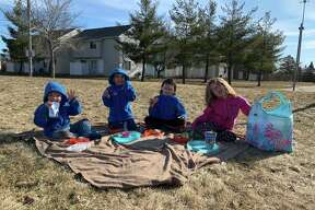 While keeping a safe distance from other people, Big Rapids mother of four Jackie Franklin has been keeping her kids active by doing fun activities like going outside for a picnic. (Courtesy photo)