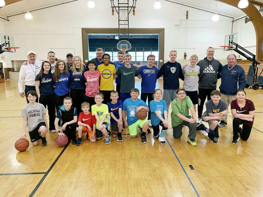 The Armory Youth Project held an inaugural youth basketball program in the months of January and February. Pictured are the participants and coaches from its final session, held last month. (News Advocate file photo)