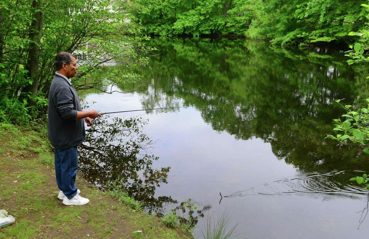 Trumbull resident Ray Falcon spends some time fishing at Twin Brooks Park in Trumbull, Conn., on Wednesday May 31, 2017. Falcon said he caught a two pond large mouth bass on his first cast but hadn't had much luck since. He usually spends two or three hours fishing and has a variety of spots he likes to hit around the park.