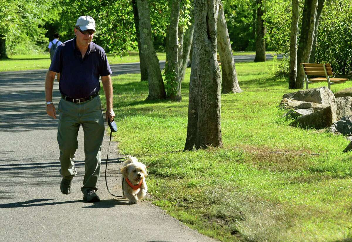 Ron Linden walks his dog Sparky through Twin Brooks Park in Trumbull, Conn. on Tuesday Sept. 15, 2015.