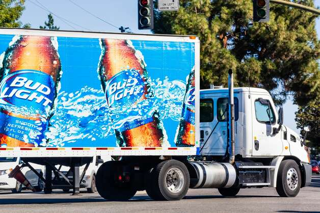 """Bud Light helping H-E-B deliveressentials The Facebook page for San Antonio's Bud Light distribution headquarters posted photos March 15 showing employees of the beer company and H-E-B working together. Bud Light said they were """"proud"""" to help the grocery chain get essentials like eggs to stores by letting H-E-B use their trucks. Photo: Getty Images"""