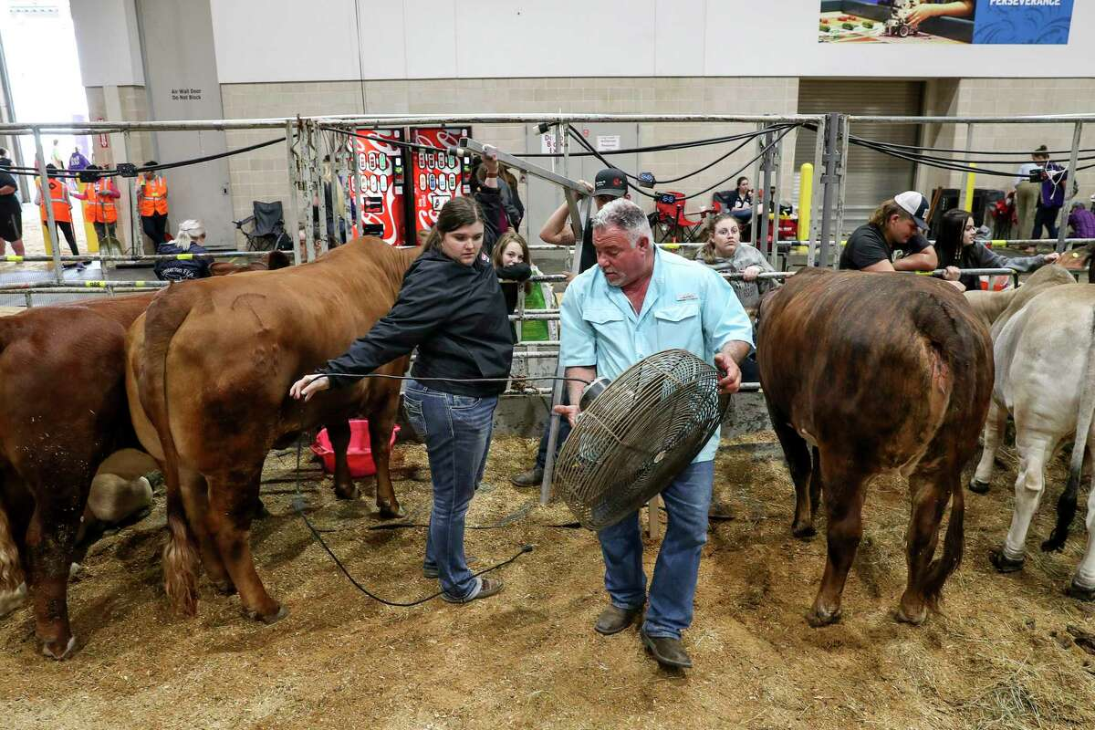 Robert Sanders, center, helps members of the Lumberton FFA pack up as they wait to leave the Houston Livestock Show and Rodeo after its cancelation was announced due to concerns about COVID-19 on Wednesday, March 11, 2020, at NRG Center in Houston.