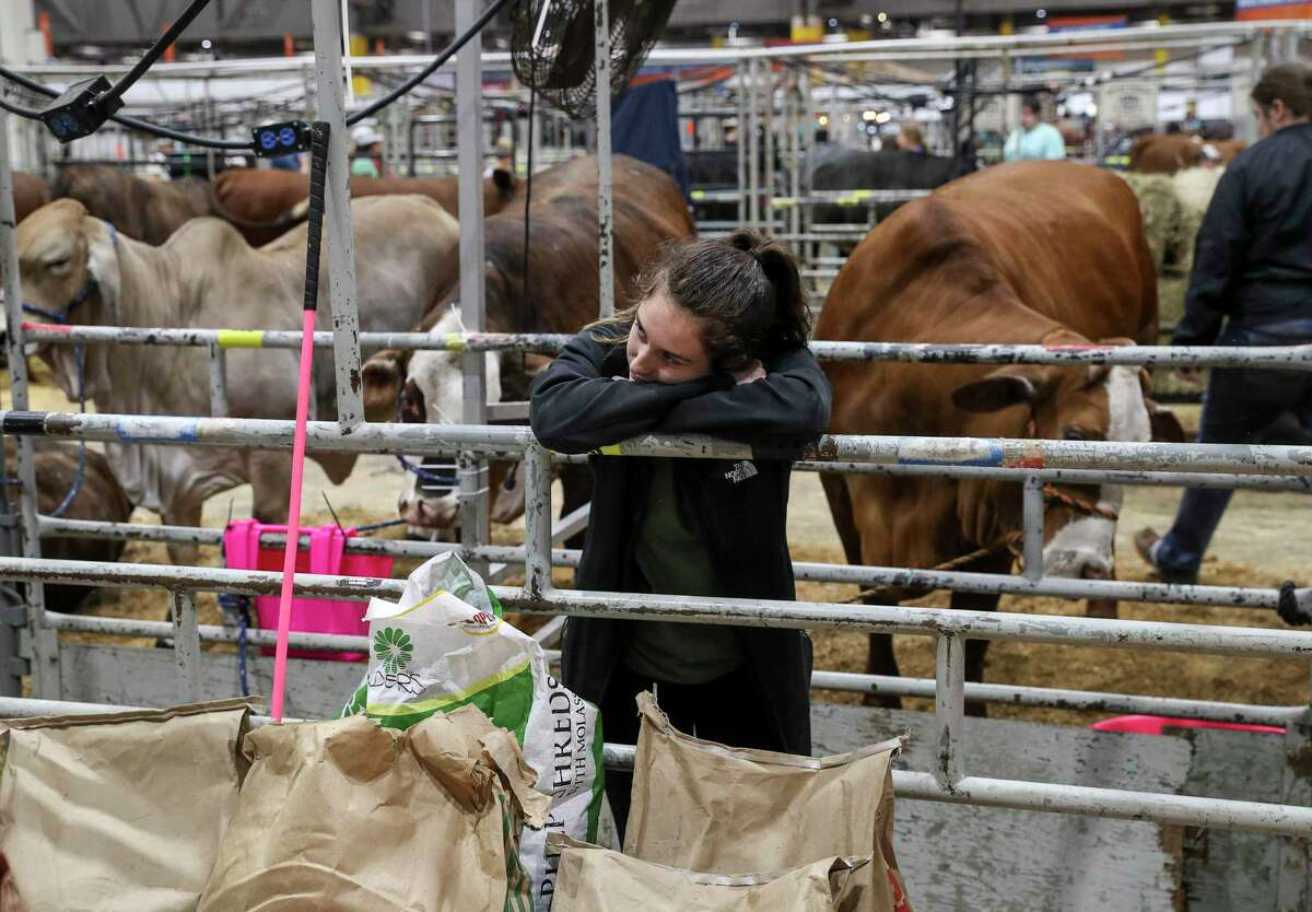 """Brooke Sanders, 17, waits to leave the Houston Livestock Show and Rodeo after its cancelation was announced due to concerns about COVID-19 on Wednesday, March 11, 2020, at NRG Center in Houston. """"I kind of hoped to go home with ribbons,"""" she said."""
