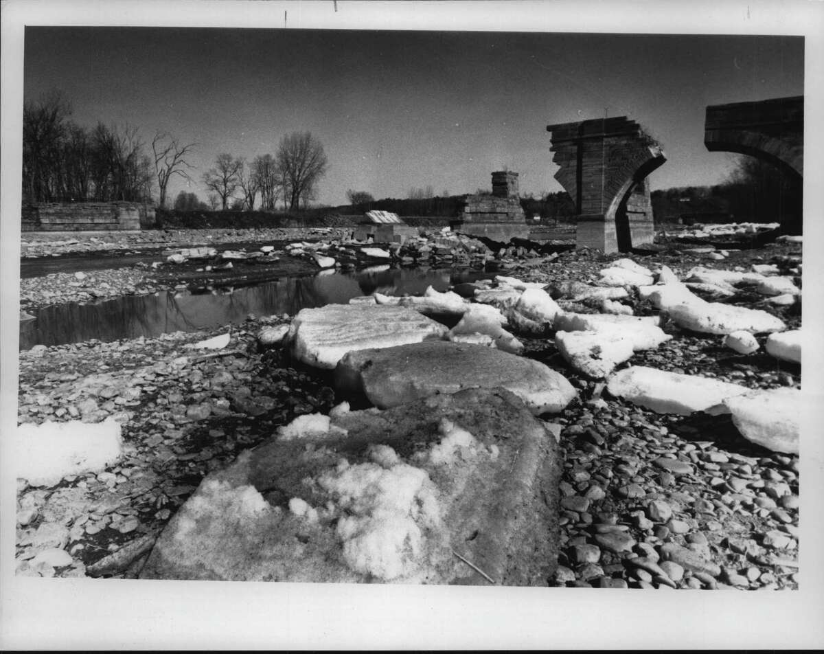 Schoharie Creek, New York. Schoharie Crossing Rt 5-s, Ft. Hunter. In the background is part of the old aqueduct at the Schoharie Crossing of Route 5-s in Fort Hunter. March 23, 1989 (Paul D. Kniskern Sr./Times Union Archive)