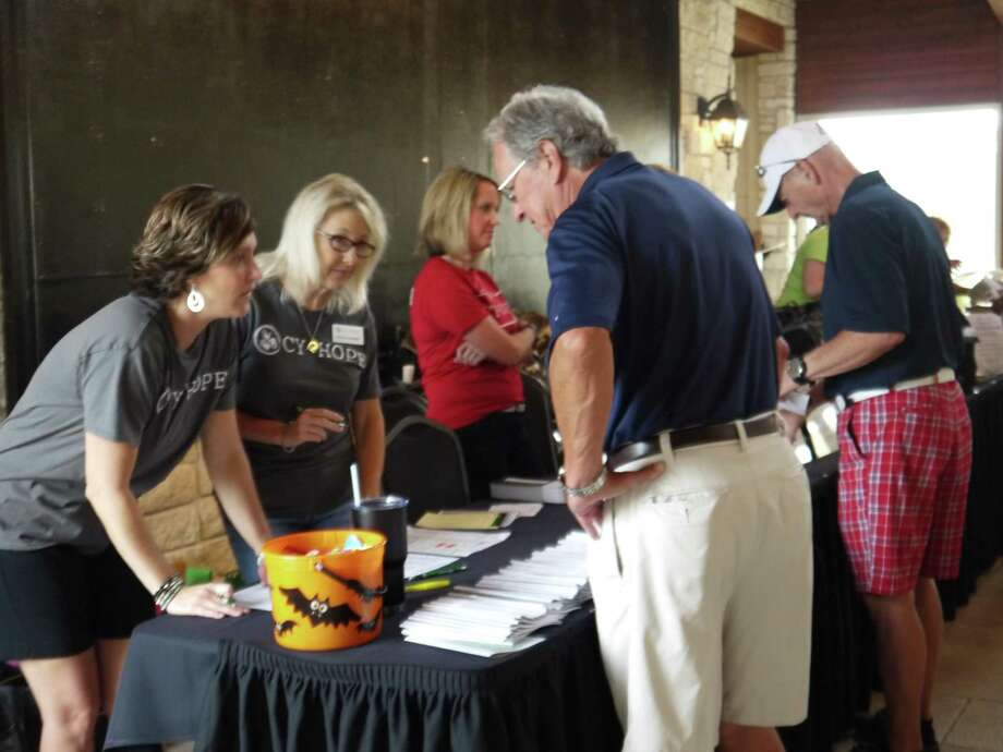 Cy-Hope volunteers help with the organization's Larry Dierker Celebrity Golf Tournament. Photo: Cy-Hope