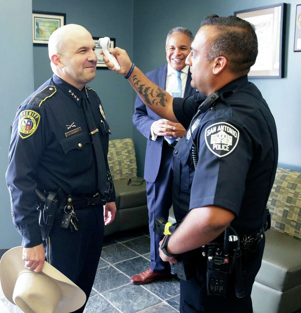 Bexar County Sheriff Javier Salazar has his temperature checked before Gov. Greg Abbott speaks at the San Antonio Operations Center on March 16, 2020. All Bexar County sheriff's deputies and San Antonio police officers are going through a similar process before they report for work.
