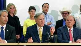 Gov. Greg Abbott, with Mayor Ron Nirenberg and County Judge Nelson Wolff, is shown in this March 16, 2020, photo. Wolff and Nirenberg believe a mandate requiring residents to wear masks when out in public is needed to help prevent the spread of the coronavirus. Although Abbott recommends wearing masks, he has stipulated that it should be voluntary.