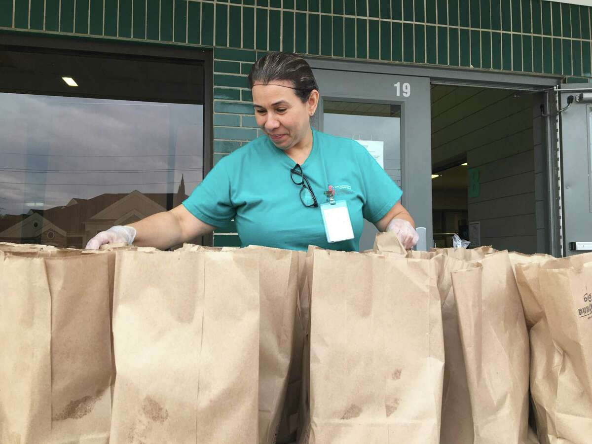 Grab and go breakfasts and lunches will be available to Katy Independent School District students amid virtual learning starting Wednesday, Aug. 19, through Friday, Sept. 4. Here, Silvia Bolivar distributes meals to families at Sundown Elementary on Monday, March 16.