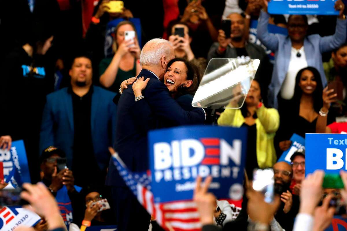 California Senator Kamala Harris (C) hugs Democratic presidential candidate former Vice President Joe Biden after she endorsed him at a campaign rally at Renaissance High School in Detroit, Michigan on March 9, 2020. (Photo by JEFF KOWALSKY / AFP) (Photo by JEFF KOWALSKY/AFP via Getty Images)