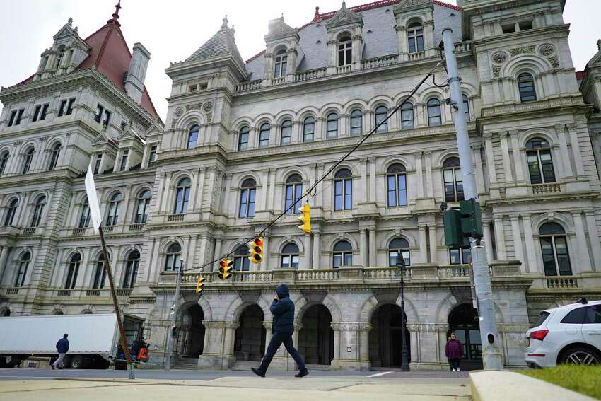 People make their was past the New York state Capitol in Albany on Wednesday, March 11, 2020. (Paul Buckowski/Times Union)