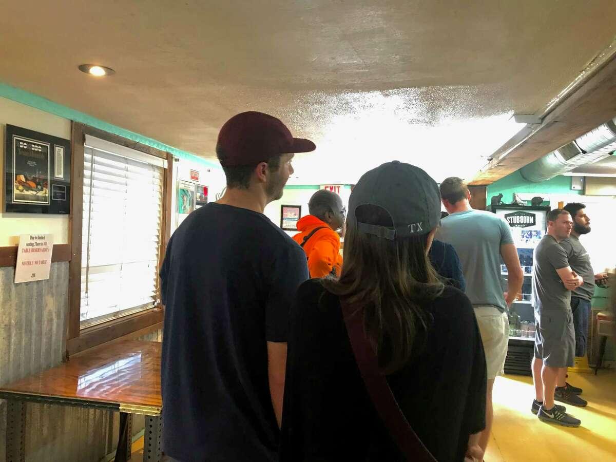 People wait in line at 2M Smokehouse in San Antonio