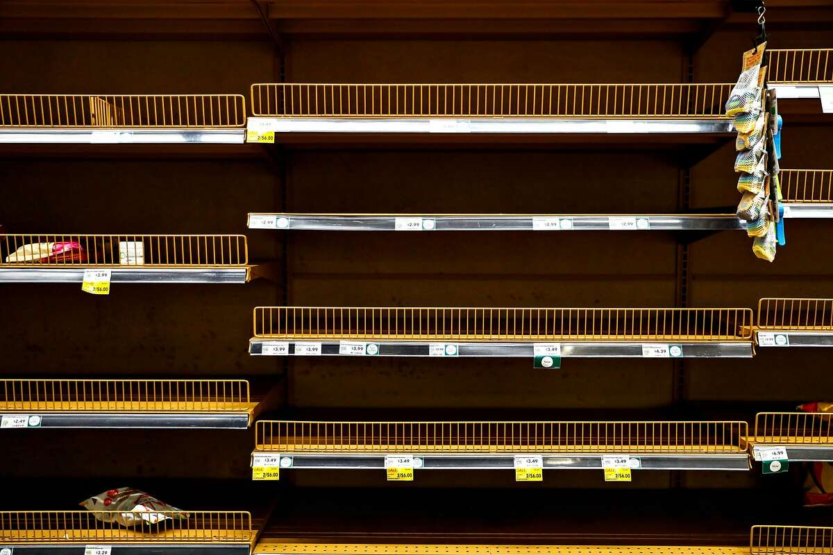 Nearly empty shelves are seen in the chip aisle at the Whole Foods in Potrero Hill on Monday, March 16, 2020 in San Francisco, California. Mayor London Breed announced that six Bay Area counties would lockdown non-essential services due to the coronavirus on Monday, March 16, 2020 in San Francisco, California.