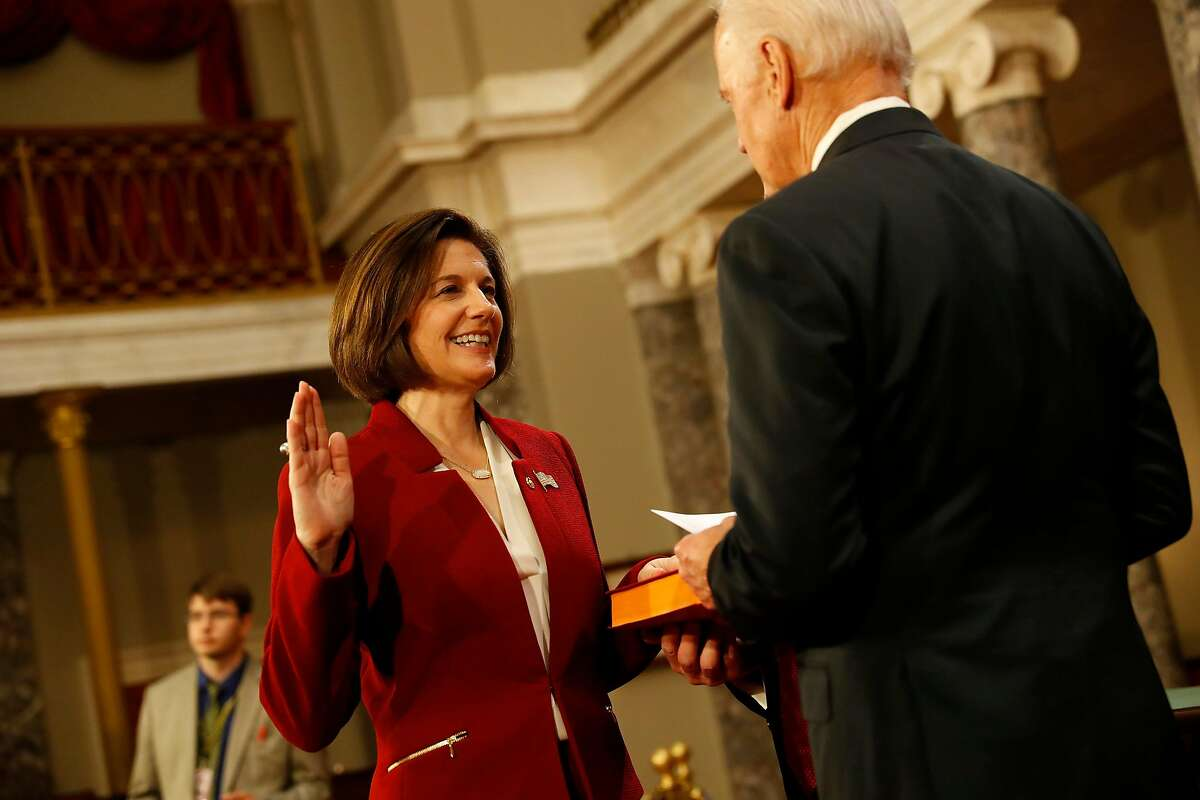 WASHINGTON, DC - JANUARY 3: U.S. Sen. Catherine Cortez Masto (D-NV) participates in a reenacted swearing-in with U.S. Vice President Joe Biden in the Old Senate Chamber at the U.S. Capitol January 3, 2017 in Washington, DC. Earlier in the day Biden swore