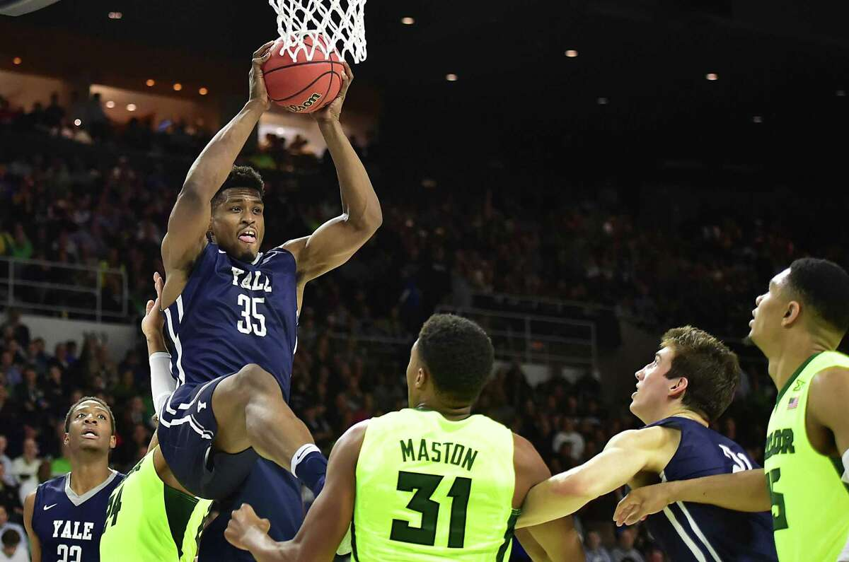 Yale senior forward Brandon Sherrod grabs a rebound in a 79-75 win over Baylor, Thursday, March 17, 2016, in the first round of the 2016 NCAA Men's Basketball Tournament at the Dunkin' Donuts Center in Providence, RI. (Catherine Avalone/New Haven Register)