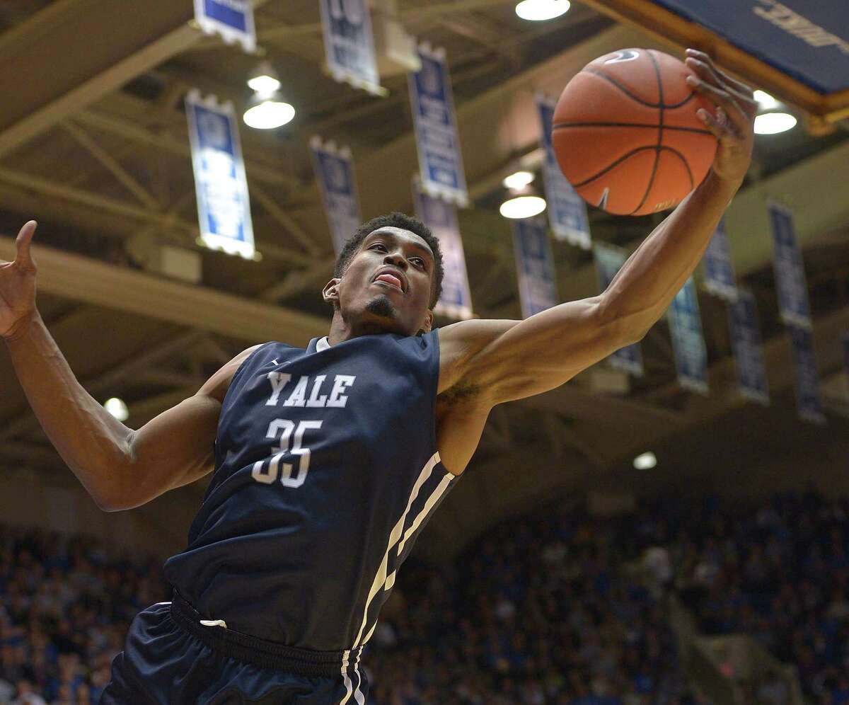 DURHAM, NC - NOVEMBER 25: Brandon Sherrod #35 of the Yale Bulldogs rebounds against the Duke Blue Devils during their game at Cameron Indoor Stadium on November 25, 2015 in Durham, North Carolina. Duke won 80-61. (Photo by Grant Halverson/Getty Images)