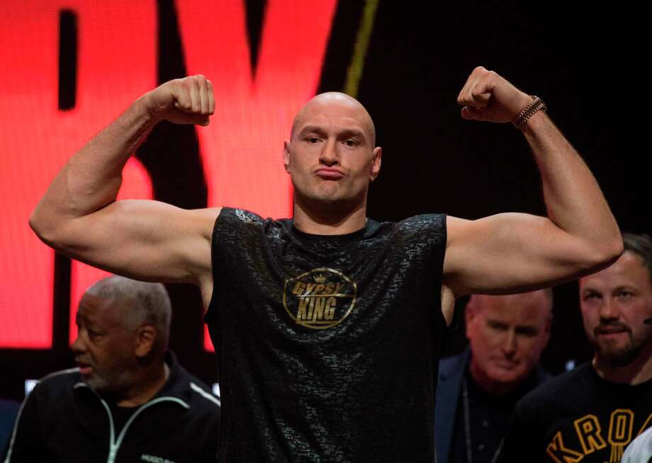 British boxer Tyson Fury flexes during his official weigh-in before his heavyweight boxing fight against US boxer Deontay Wilder at the MGM Grand Las Vegas in Las Vegas, Nevada on February 21, 2020. - The boxers will fight for the World Boxing Council (WBC) Heavyweight Championship Title on February 22, 2020 at the MGM Grand Garden Arena in Las Vegas. (Photo by Mark RALSTON / AFP) (Photo by MARK RALSTON/AFP via Getty Images) Photo: MARK RALSTON / AFP or licensors