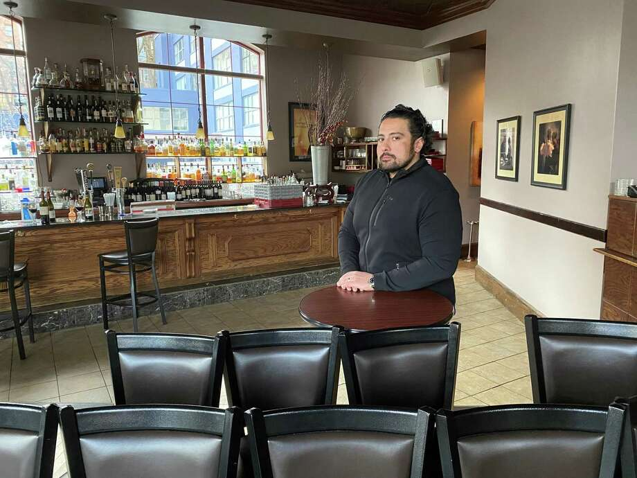 Dominick Purnomo, owner of dp An American Brasserie, at his empty downtown Albany restaurant located inside the Hampton Inn, on Monday, March 16, 2020, the day when mandatory closures to slow the spread of coronavirus took effect across the state.(Steve Barnes/Times Union) Photo: Steve Barnes/Times Union