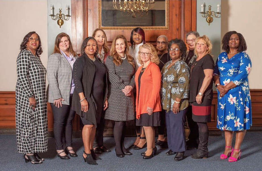 "This year's YWCA of Alton's Women of Distinction award recipients are, from left, back, Rosetta Brown, Monica Ellebracht, Virginia Woulfe-Beile, Kendra Stiff, Olivia ""Ann"" Irvin and Nancy Berry; front, Dr. Wendy Adams, state Senator Rachelle Crowe, Robyne O'Mara, Sherry McCrady, Lisa Hayes and Angela Gray. Photo: For The Telegraph"