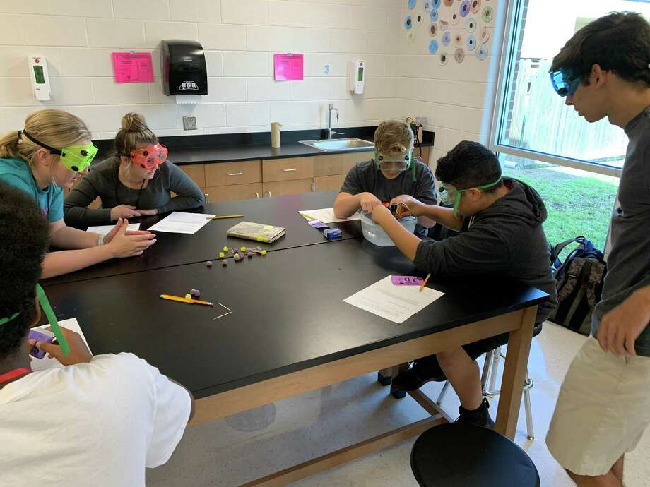 Debra Nolte's Hargrave High School AP Chemistry students teach a lesson to Huffman Middle School eighth graders on Oct. 15 Photo: Shirley Dupree, Huffman ISD