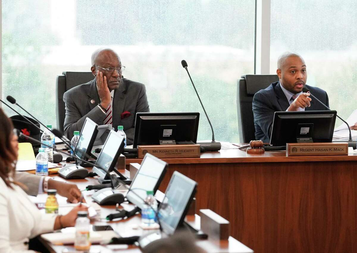 Texas Southern University's board of regents Kenneth Huewitt, acting president, left, and Hasan Mack, chair, right, are shown during board meeting Thursday, Feb. 19, 2020 in Houston. The board is meeting for the first time since giving their notice of termination for sidelined TSU president Austin Lane earlier this month.