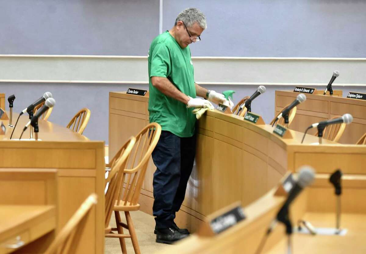 New Haven, Connecticut - Friday, March 16, 2020: Donny Grande of Performance Environmental Services is part of a crew of two people who are disinfecting the New Haven City Hall Aldermanic Chambers Monday amidst the public health concern over the Coronavirus / COVID-19 outbreak.