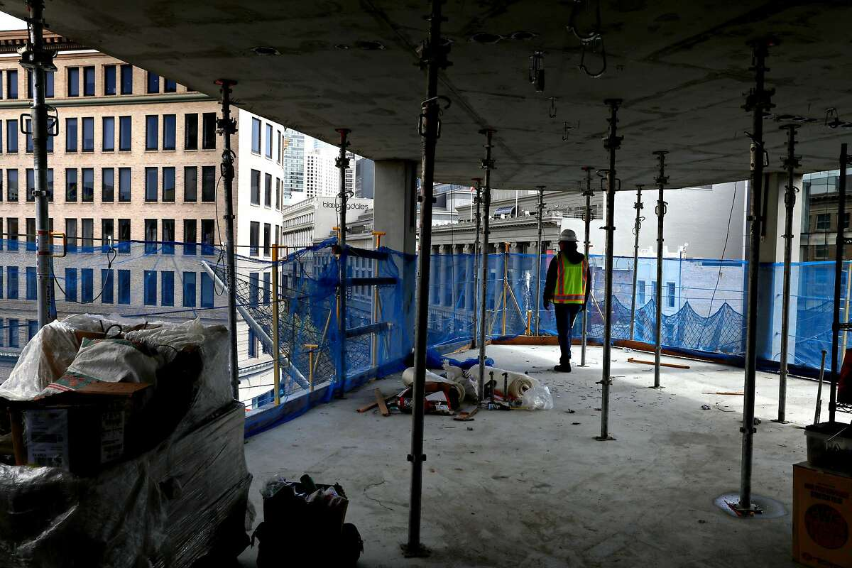Developer Eric Tao shows a corner condo construction taking place on the sixth floor of 950 Market St., a hotel/condo development, seen on Friday, March 13, 2020, in San Francisco, Calif.