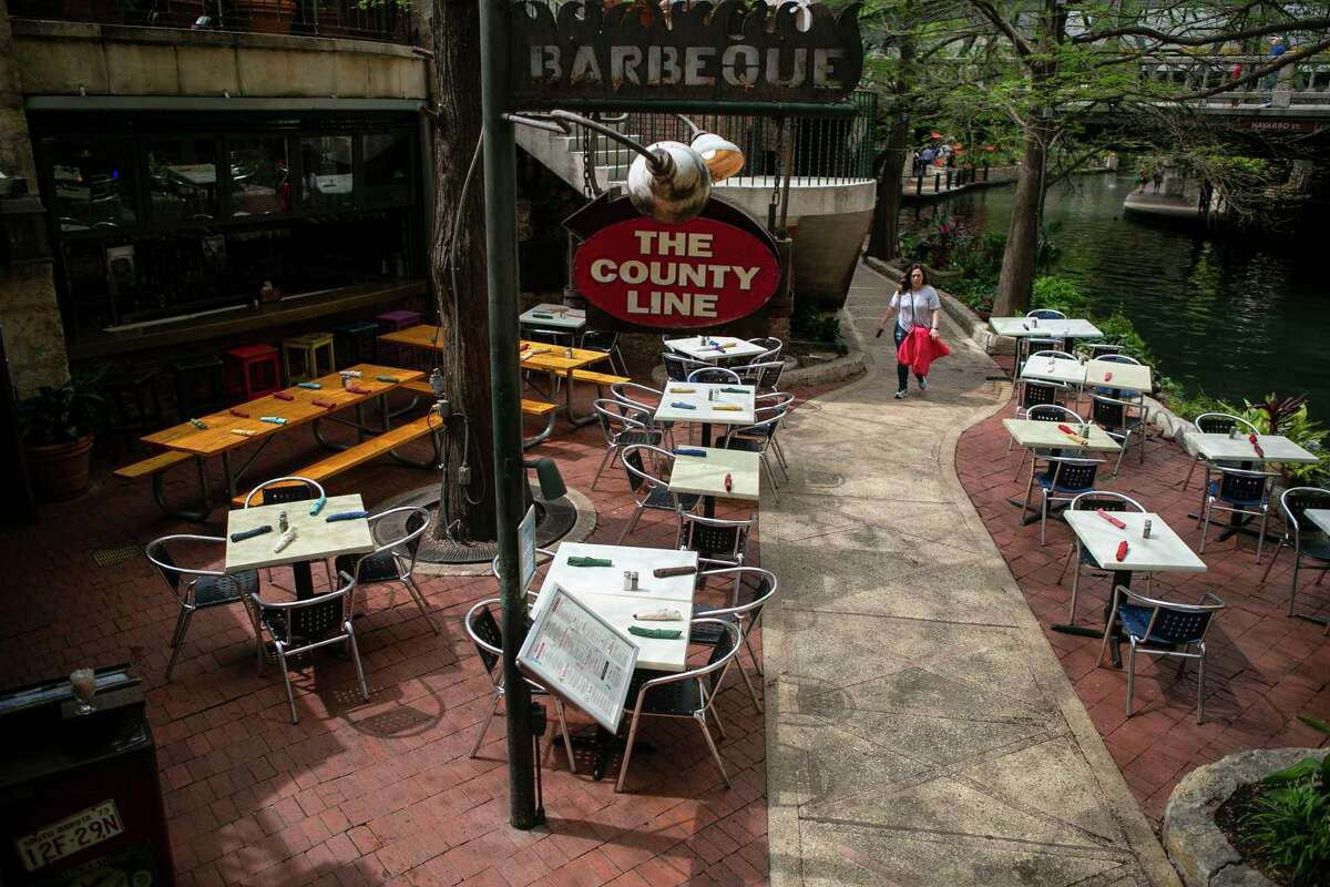 Many tables sat empty at The County Line restaurant on the River Walk in San Antonio on March 16, 2020. Tourism has dropped off at all of the River Walk spots since the coronavirus outbreak.