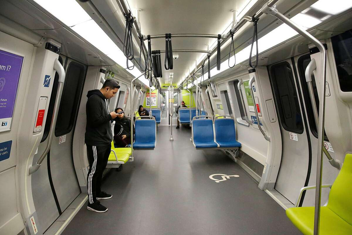 Jorge Quila of San Francisco is one of the few passengers riding on a BART train on Monday, March 16, 2020 in San Francisco, Calif. Quila was careful not to sit or touch railings on the BART train as he rode it due to concerns of the coronavirus.